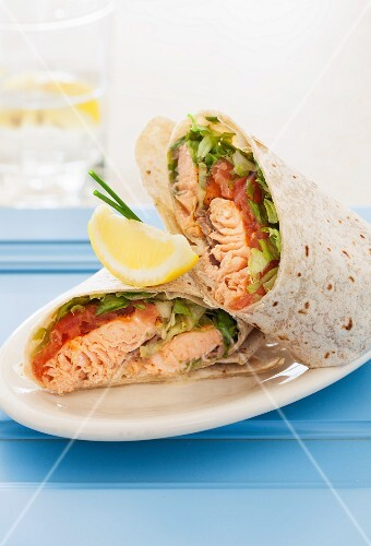 Salmon wraps with mustard, tomato and lettuce