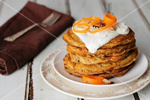 Carrot pancakes with cream cheese sauce and pecan nuts