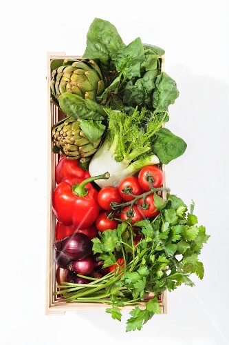 Vegetables and parsley in a wooden basket