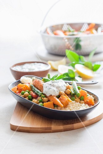 Moroccan vegetables on a bed of couscous with mint yoghurt