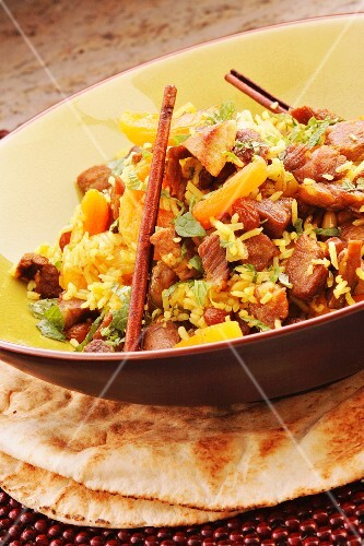 Turkish pilau rice with lamb, dried fruits, cinnamon and unleavened bread