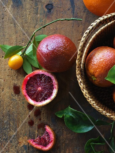 Blood oranges on a rustic wood table