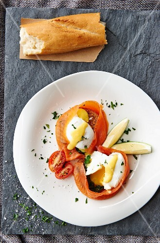 Poached eggs wrapped in salmon served with baguette