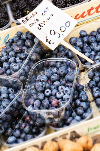 Blueberries in plastic punnets at a market