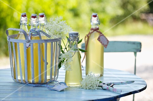 Elderflower syrup on a garden table