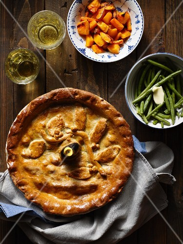 A pie with sides of vegetables