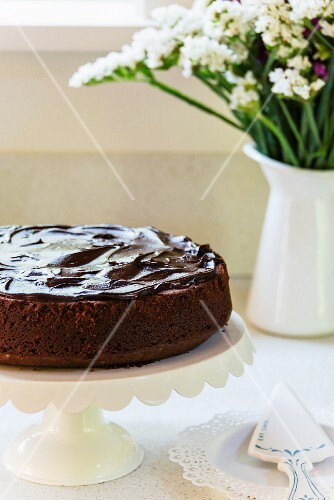 Homemade chocolate cake on a cake stand
