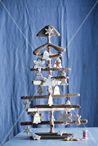 Iced biscuits decorating wooden Christmas tree