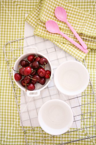 Cherries in a white baking dish