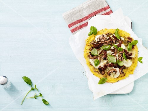 Polenta pizza with mushrooms, mozzarella and basil