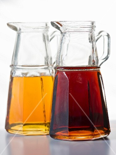 Two type of maple syrup in glass jugs
