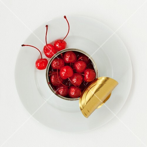 An opened tin of cocktail cherries