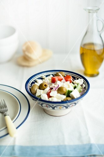 Greek salad with olive oil and pita bread