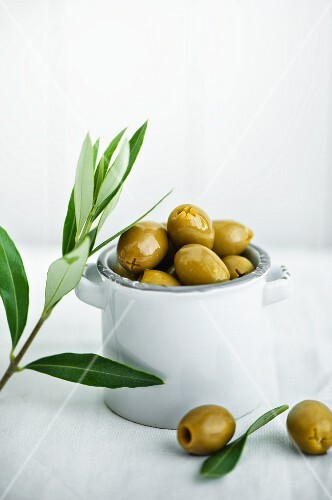 Green olives in a small ceramic bowls