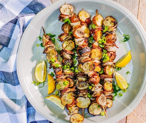 Grilled potato skewers with onions