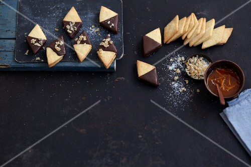Short crust diamond biscuits dipped in chocolate with marmalade