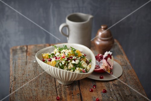 Couscous salad with pomegranate seeds