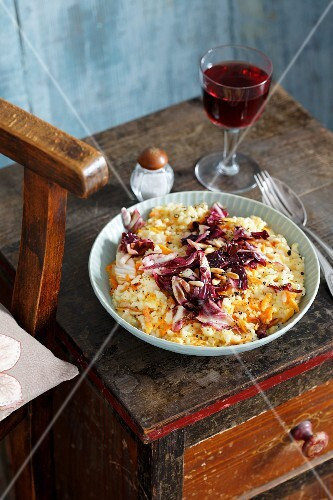 Carrot risotto with radicchio and pine nuts