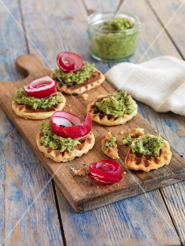 Savoury waffle canapes with herb cream and radishes