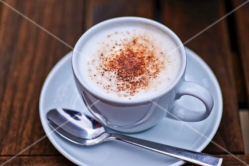 A cappuccino with cocoa powder