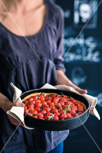 A cherry tomato tart in a baking tin