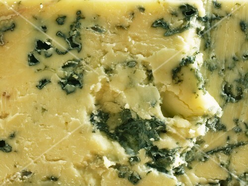 A close-up of a piece of Cropwell Bishop Stilton cheese