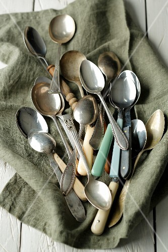 Various coffee spoons on a cloth