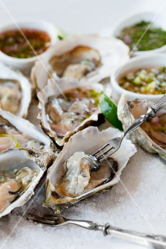 Fresh oysters with various sauces