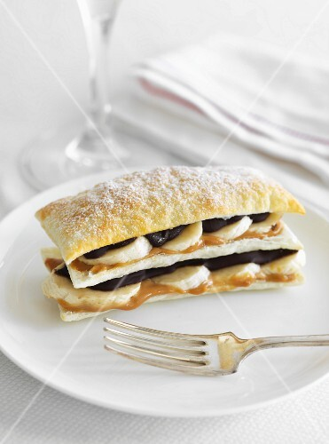 Banoffee layered pastries with icing sugar