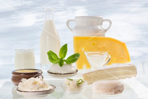 An arrangement of various different dairy products (milk, sour cream, cheese, quark)