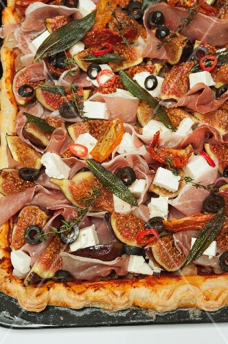 Pissaladiere with riccotta, feta, figs, onions and olives
