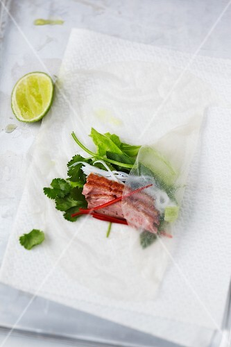 Rice paper rolls with duck breast and vegetables being made