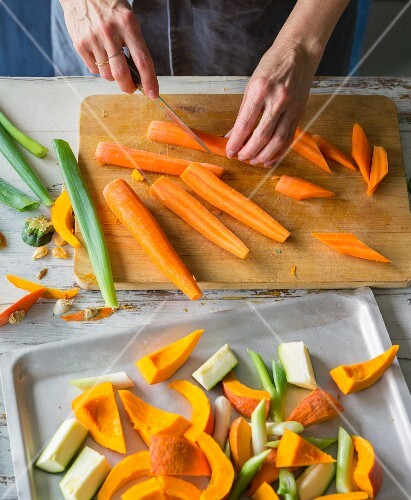 Oven roasted vegetables being made: carrots being chopped