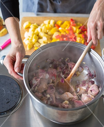Goulash soup being made: meat and onions being fried