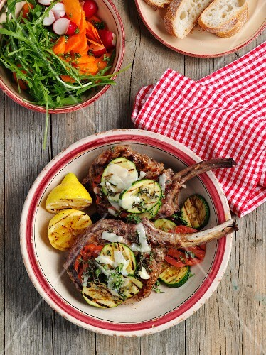 Grilled veal chops with vegetables, salad and white bread