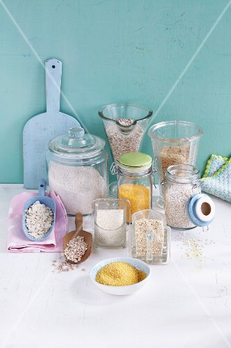 Various different types of cereals in glass containers