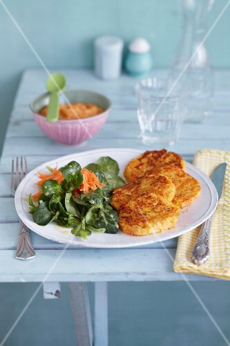 Baby food and potato cakes with salad