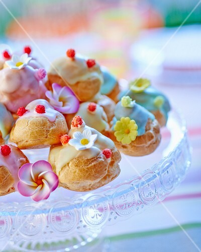 Choux pastries topped with colourful icing sugar
