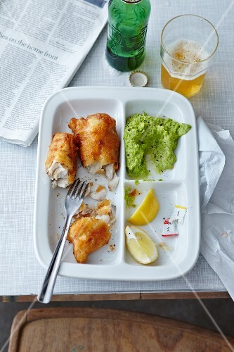 Fish and mushy peas on a three section plate