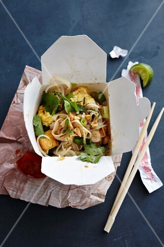 Pad Thai (rice noodle dish, Thailand) in a takeaway box