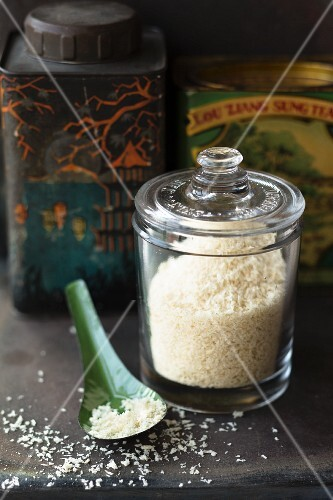 Panko in a jar with a lid in front of a vintage tea caddy