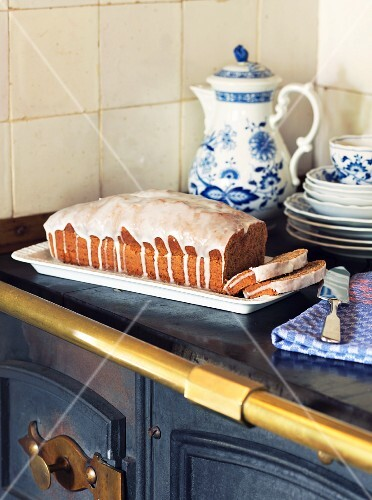 Spiced cake with icing sugar on an old kitchen range