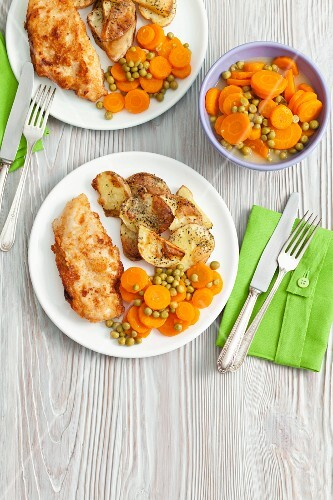 Chicken breast with fried potatoes and a pea and carrot medley