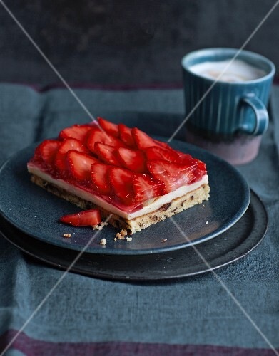 A slice of strawberry tray bake cake