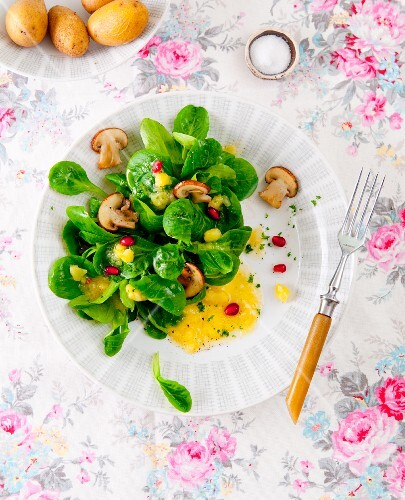 Lamb's lettuce with potato vinaigrette, mushrooms and pomegranate seeds