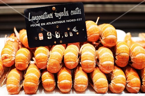 Langoustines on a market stall with a price label