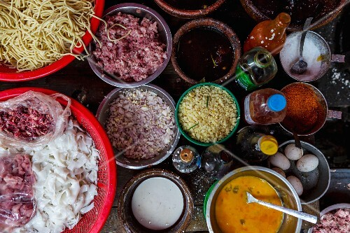 Ingredients for noodle dishes at a street bar in Yangon, Myanmar