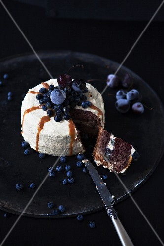 A sliced caramel and blueberry cake