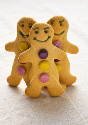 Gingerbread men decorated with colourful chocolate beans