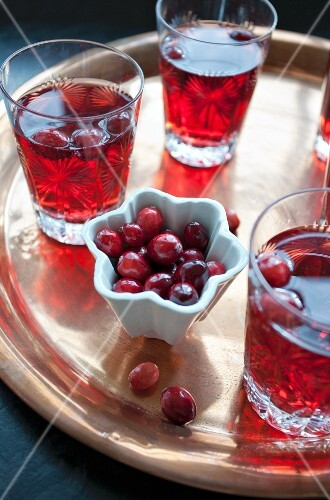 Glasses of cranberry juice on a tray